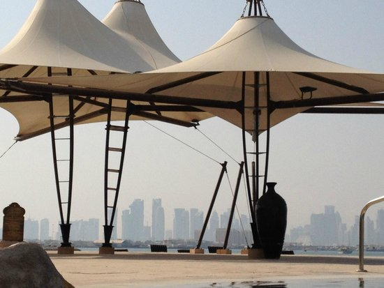 Sharq Village & Spa: city view from pool