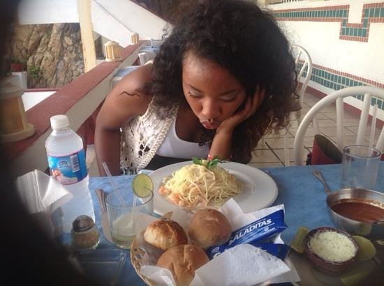El Mirador Acapulco Hotel: Daughter blowing on the hot shrimp alfredo.