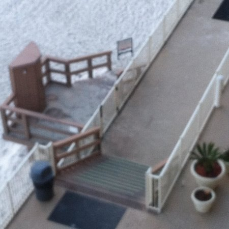 """Treasure Island Resort Condominiums: more sand on after you """"sprayed"""" sand off.  cleaned last two days."""