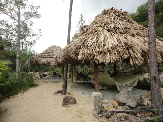Gaia Riverlodge: The hammocks and chairs down by the waterfall