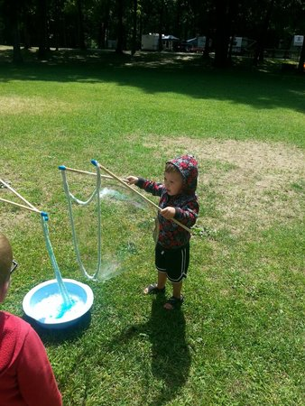 Emmett, MI: Fun making giant bubbles as part of the park activities set up for kids