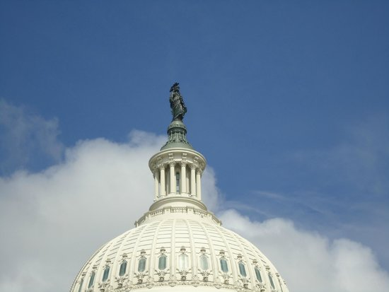 Capitol Hill: The Statue of Freedom, on top of the building.