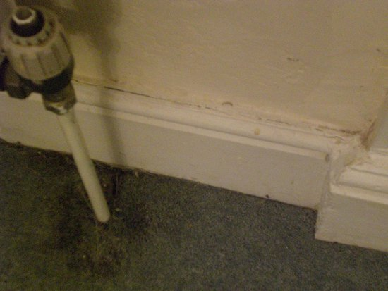 St Hilary, UK: Damp/wet patch under leaking radiator