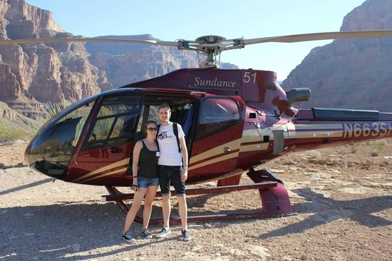 Sundance Helicopters: Our helicopter with canyon background