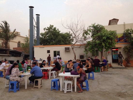 Early diners on a sandstormy summer evening...