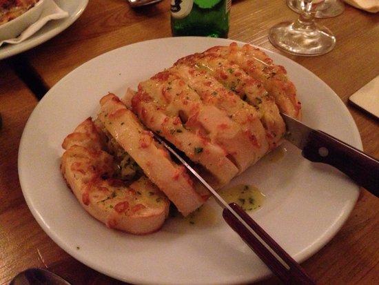 "Ginali's: A ""single"" portion of cheesy garlic bread."