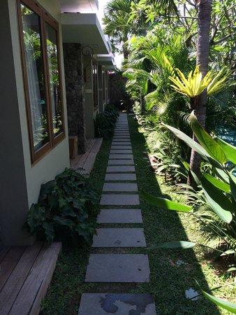 Uma Karan: Pathway along the side of pool to rooms