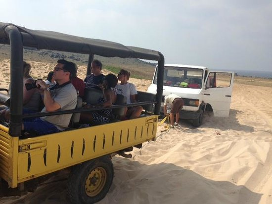 De Palm Tours: Ludwig and Juan helping to pull out a truck driver stuck in deep sand.