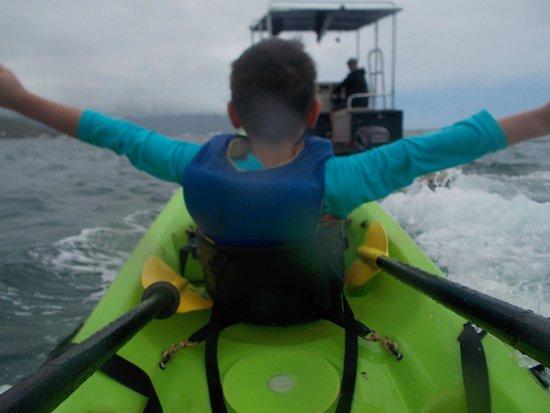 Holokai Kayak and Snorkel Adventure : Banana Boat!! Parker pulling our kayak back to He'eia Kea