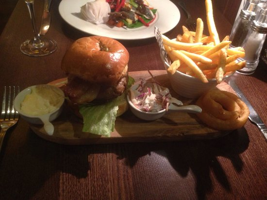 Harry's Bar & Grill: Veal burger with bacon tomato chilli coleslaw onion rings and skinny fries.
