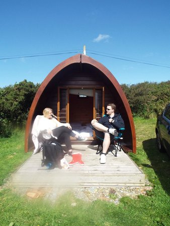 Treligga, UK: View of our Pod with us on the decking.