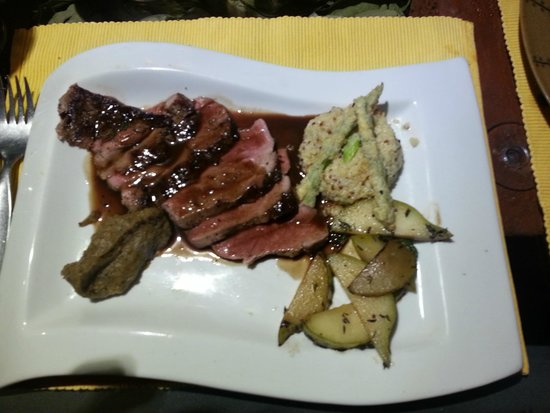 El Huacatay: alpaca loin with port thyme sauce, quinoa risotto, pear with thyme, and eggplant puree