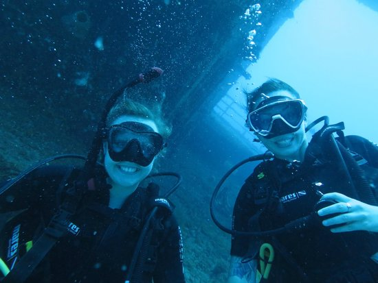 Quality Time Divers: Nicola & Megsi infront of the shipwreck Odyssey