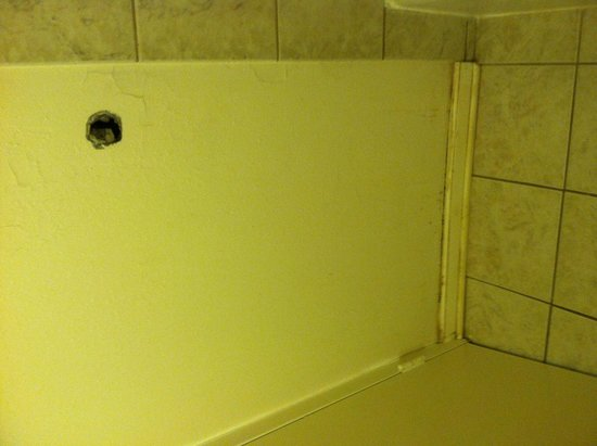 Hole in bathroom wall and dirty baseboard - Picture of Super 8 ...