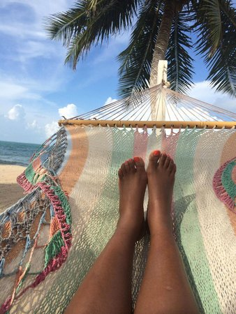 Almond Beach Resort & Spa: Swinging by the beach and gazing up at the clouds