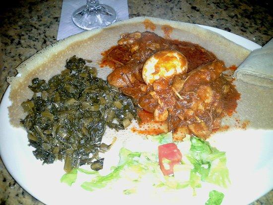 Nile Ethiopian Restaurant: Doro Wat: stewed chicken in red pepper sauce, hard boiled egg and side of collard greens. My fav