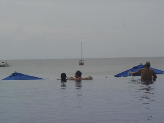 The Bellevue Resort Bohol: my son and my husband enjoying the pool