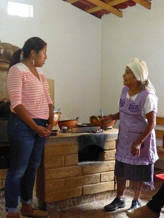 Fundacion En Via : A chocolate + mole business with local entrepreneur (right) and translator