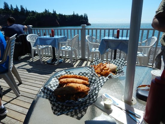 The Caves Restaurant: The Caves view ...Fish n Chips and Burger Platter