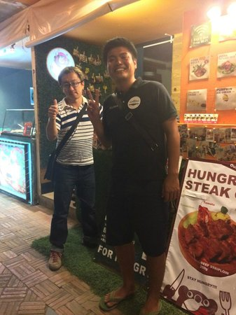 "HUNGRY BEAR at Angkor Night Market: With owner ""KUMA-san"" (right side) in front of HUNGRY BEAR"
