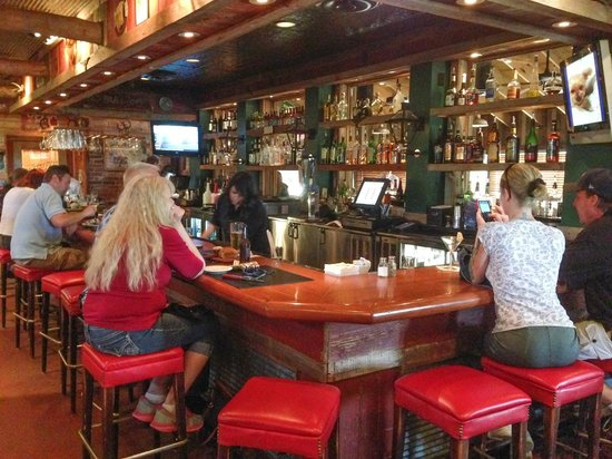 Saltgrass Steak House: Bar area is separate from main dining area and has TVs