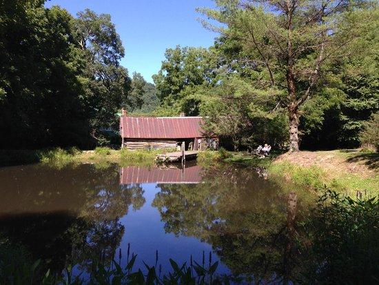 The Mast Farm Inn: Mast Farm Inn pond, cottages (blacksmith shop and woodworking ship)