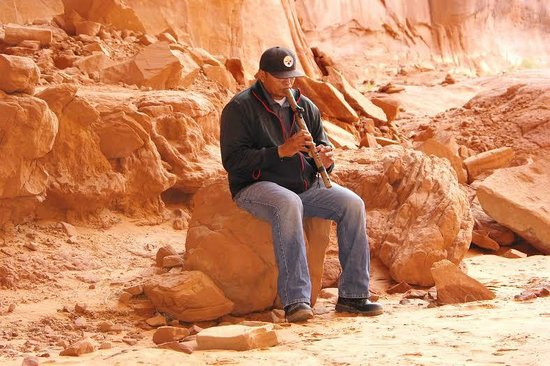 Monument Valley Safari: Bobby playing flute in the Big Hogan, Monument Valley