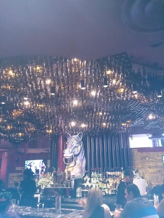 Hard Rock Cafe: Hanging beer bottle display from the ceiling over the bar
