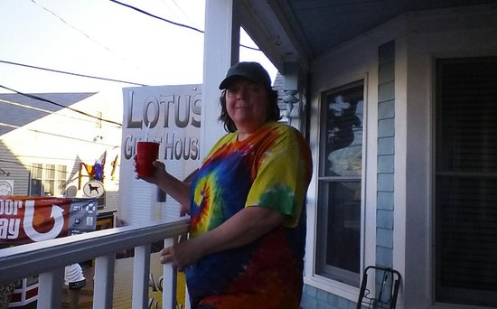 Lotus Guest House: Sue enjoying a libation on the balcony