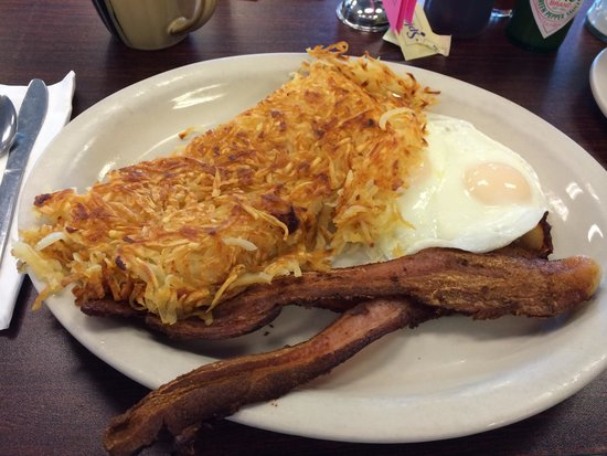 Breakfast at Valerie's: Basic bacon, 2 eggs and shredded hash browns.  Yum!