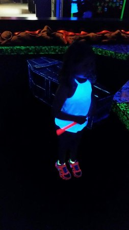Monster Mini Golf: My daughter glowing. Lol
