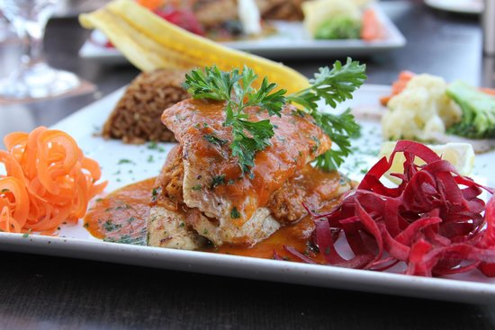 Canoa: Crab stuffed red snapper with a red pepper sauce