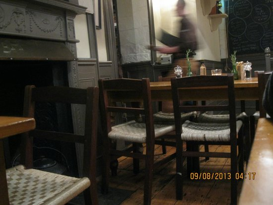The Boxty House: Busy waiter breezing through the dining area; traditional furnishings for diners