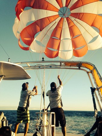 X-Treme Parasail: Guys packing the parachute at the end of sailing trip