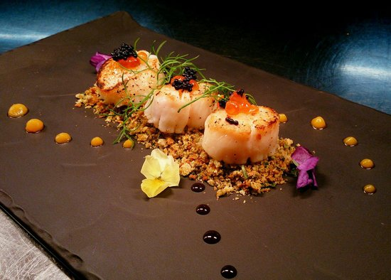 The Prince of Wales: Pan seared scallops served on gremolata topped with lumpfish and salmon caviar, finished with sw