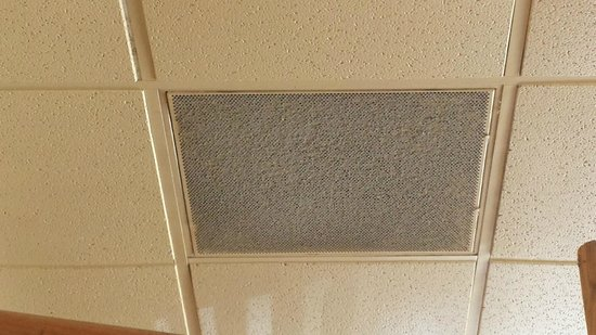 Rosa's Cantina: dirt and dust on intake vent above booth