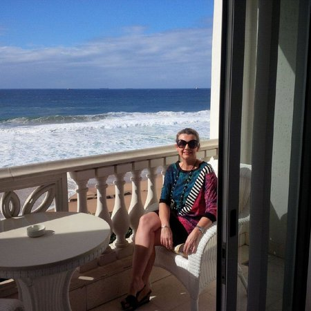The Oyster Box: My wife on the balcony of our room