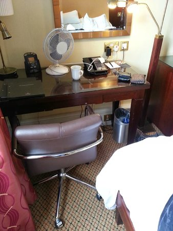 Hilton Nottingham : There's a desk in the room, and a chair, but the room is so small you can barely get past the ch