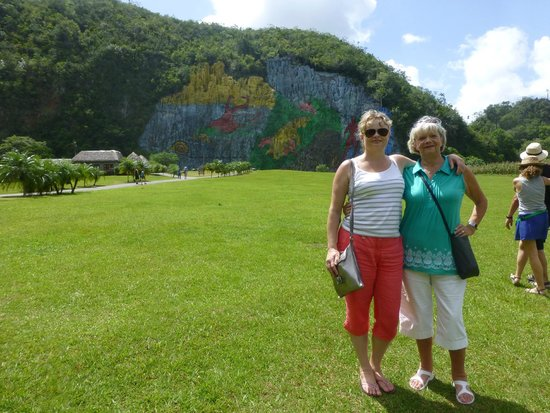 Hotel Inglaterra: Vinales tour - prehistoric murals in backgournd on hill