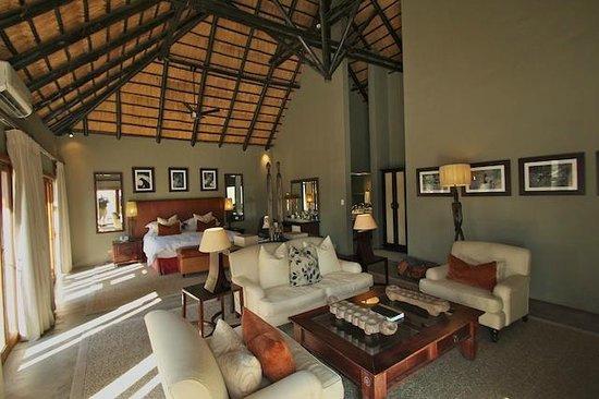 Dulini River Lodge : Room #8 interior: lounge and bedroom