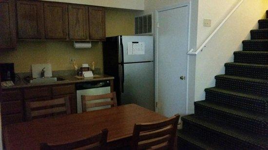 Sonesta ES Suites Providence - Airport: full kitchen with utensils, plates, cups etc