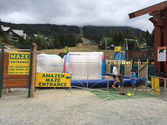 Family Adventure Zone: Entrance to the maze, water rollers and airbag jump.   All next to the mini golf course