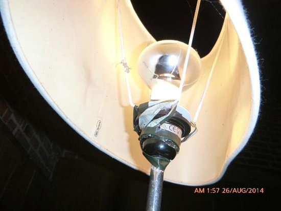 Brenley Farm: Lamp held up with duct tape - surely more of a fire hazard than a sofa throw