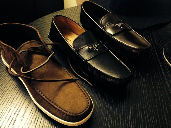 Montevarchi, Italia: The two loafers are Prada. Black ones were 147 Euro after VAT refund. Brown ones were 78 Euro.