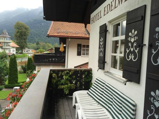 Hotel Edelweiss: Our view.. this is our private balcony, looking down on the gardens and the mountains