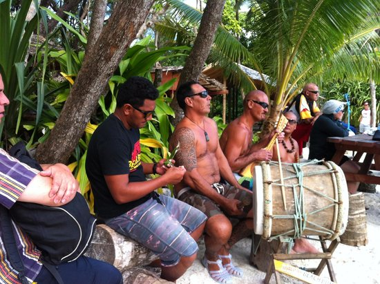 Captain Tama's Lagoon Cruizes: Captain Tam's Crew playing their music on the beach