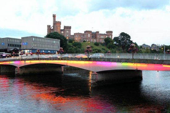 A view of the River Ness and of Inverness Castle and the lit up bridge
