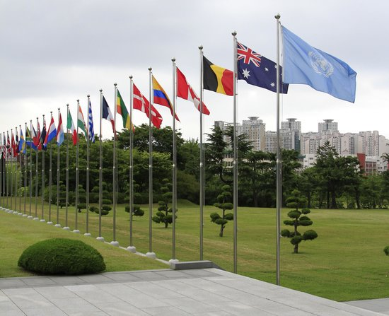 Korean Military Honor Guard approaches to raise UN flag  - Picture