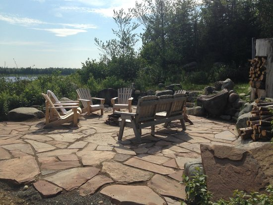 Riverfront Chalets & Rafting Newfoundland: Flagstone Fire Pit is Perfect for Roasting Marshmallows at Night
