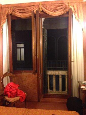 """Hotel Lisbona: Room view toward window and """"door"""" window"""